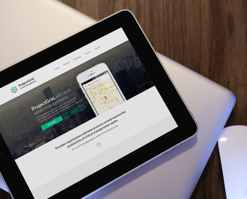 Websites for manufacturers. Website displayed on an iPad resting on top of a MacBook Pro